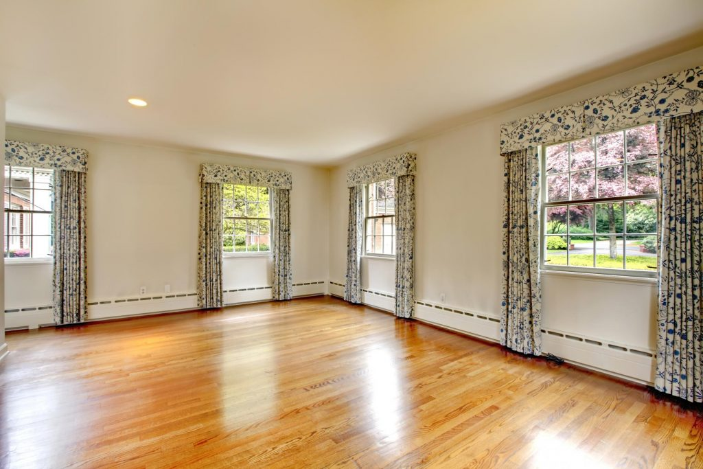 a newly renovated room with floral curtains